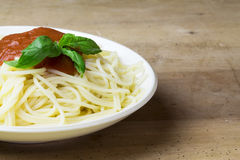 Plate of gluten free spaghetti with tomato sauce and basil Royalty Free Stock Photos