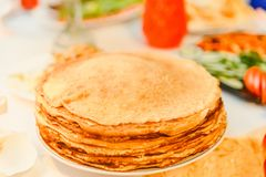 Plate of Golden pancakes, the traditional Russian holiday of Maslenitsa. Plate of Golden pancakes, the traditional Russian holiday of Maslenitsa, food stock photography
