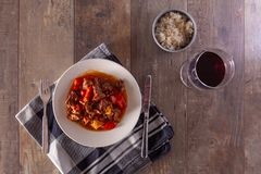 A plate with goulash or beef stew on the table. Photographed in a flat top down view royalty free stock photo