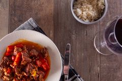 A plate with goulash or beef stew on the table. Photographed in a flat top down view royalty free stock image