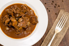Plate with goulash and silver fork Stock Photos