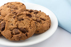 Plate of gourmet milk chocolate chip cookies with blue napkin Stock Image