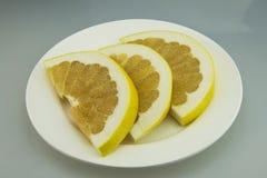 Plate, grapefruit, sliced Royalty Free Stock Photo