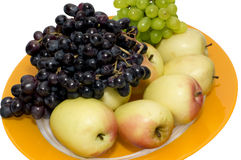 The Plate of grapes and apples Royalty Free Stock Images