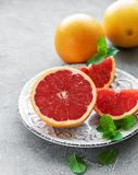 Plate with graprfruits. On a concrete background stock photos
