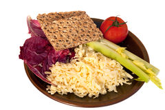 Plate of grated Cheddar cheese and salad items Stock Photo