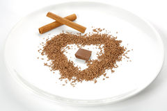 A plate with grated chocolate and cinnamon Royalty Free Stock Images