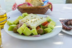 Plate of Greek salad with feta cheese Stock Photo