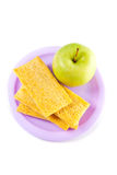 A plate with green apple and crisps Stock Image