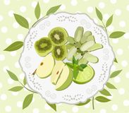 Plate with green fruits and mint top. Vector illustration. Stock Photo
