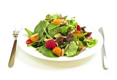 Plate of green salad on white background Royalty Free Stock Photography