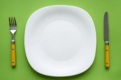 Plate on green Stock Photography