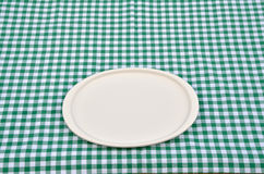 Plate on a green-white tablecloth Stock Photo