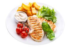 Plate of grilled chicken breast with vegetables royalty free stock photos