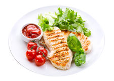 Plate of grilled chicken breast with vegetables Royalty Free Stock Images