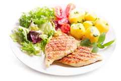 Plate of grilled chicken breast with vegetables Stock Photos