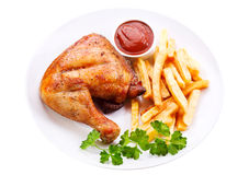 Plate of grilled chicken leg with fries Royalty Free Stock Images