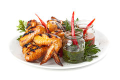 Plate of grilled chicken wings with sauce. Stock Photo