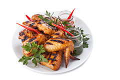 Plate of Grilled Chicken Wings with Sauce. Royalty Free Stock Photos