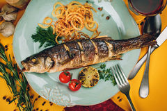 Plate of grilled fish with squid and tomatoes Royalty Free Stock Photos