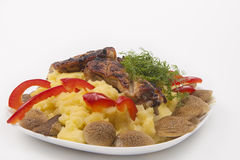 Plate with grilled fresh meat and mash potato, mashrooms and veg Stock Photography