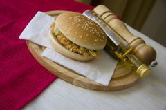 Plate of grilled hamburger and glass of cold beer Royalty Free Stock Photography