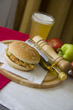 Plate of grilled hamburger and glass of cold beer Stock Photo