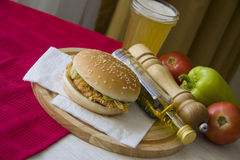 Plate of grilled hamburger and glass of cold beer Stock Photos