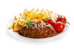 Plate of grilled meat with french fries Royalty Free Stock Image