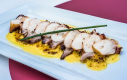 A plate of grilled octopus Stock Images