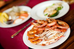 Plate with grilled prawns and crab Royalty Free Stock Photos