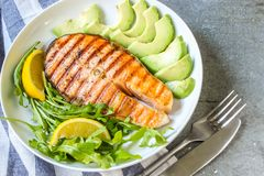 Plate of grilled salmon steak with vegetables Royalty Free Stock Images