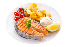 Plate of grilled salmon steak with vegetables Stock Image
