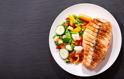 Plate of grilled salmon steak with vegetables stock photo