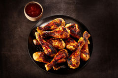 Plate of grilled spicy chicken with chili sauce royalty free stock photos