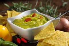 Plate of guacamole with tortillas Stock Image