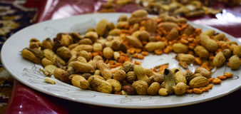 Plate half filled with peanuts Royalty Free Stock Photo