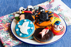 Plate of halloween cookies on towel Royalty Free Stock Photography