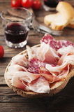 Plate with ham, bacon, salami and bread Stock Photos