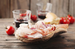 Plate with ham, bacon, salami and bread Royalty Free Stock Images
