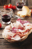 Plate with ham, bacon, salami and bread Stock Images