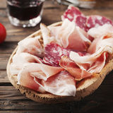 Plate with ham, bacon, salami and bread Royalty Free Stock Photo