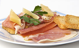 Plate of ham and cheese canapes Stock Photography