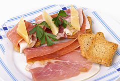 Plate of ham and cheese canapes Royalty Free Stock Photos