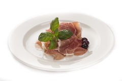 Plate of ham with cheese decorated. ! Basil, olive and parma ham Stock Image