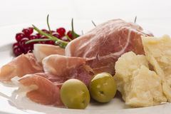 Plate of ham with cheese, parsley and currants 2. Plate of ham with cheese, parsley and currants well ddecorated on white plate Royalty Free Stock Image