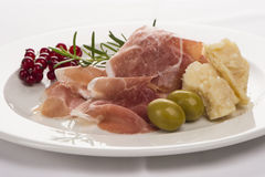 Plate of ham with cheese, parsley and currants. Well ddecorated on white plate Stock Image