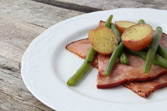 Plate of ham, green beans and creamer potato. Cooked in butter Royalty Free Stock Photos
