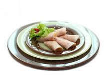 A plate with ham rolls. And vegetables for restaurant Royalty Free Stock Photo
