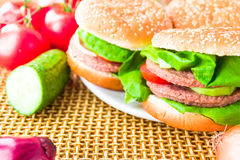 Plate hamburgers wooden mat Royalty Free Stock Photography